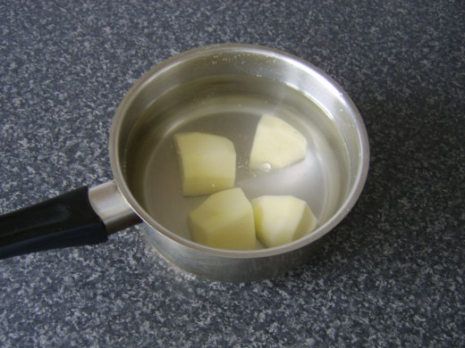 Peel and quarter the potato and add it to a pot of cold, slightly salted water
