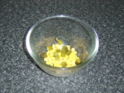 Sweetcorn and chopped pickles are added to a mixing bowl