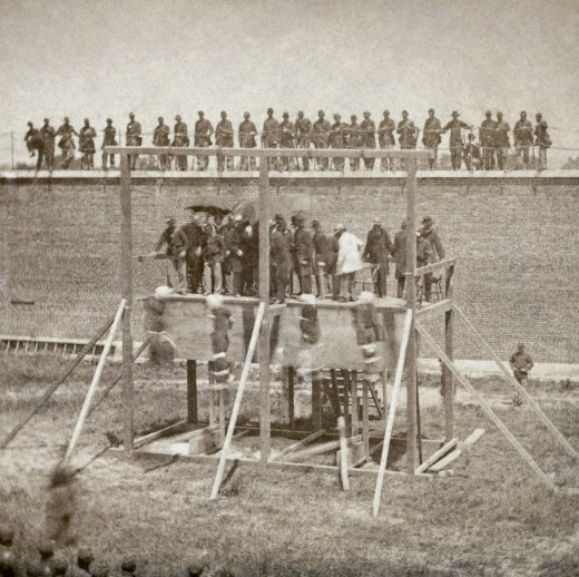 Execution of Mary Surratt, Lewis Powell, David Herold, and George Atzerodt, conspirators of Abraham Lincoln assassination, on July 7, 1865 at Fort McNair in Washington, D.C. 1 photographic print on stereo card