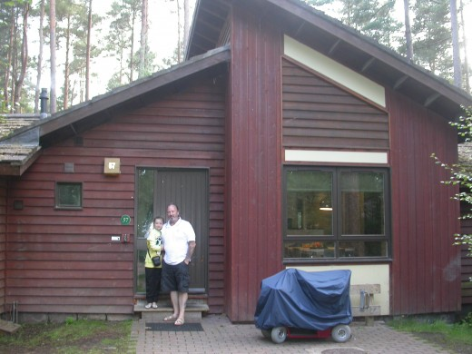 Chris and Lyndsey outside our woodland lodge.