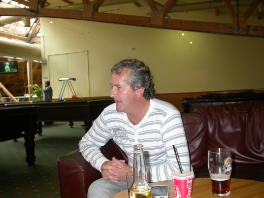 My brother David in the bar watching footie.