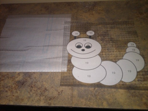 Putting picture on top of adhesive.