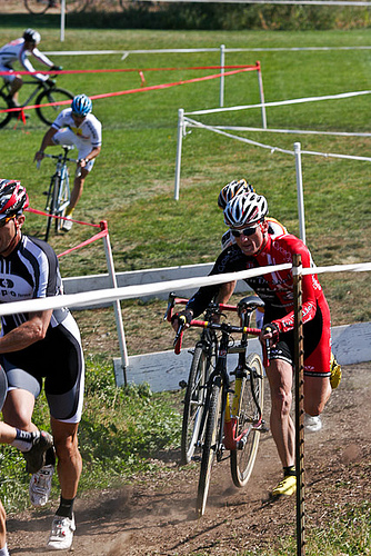Cyclo cross in action- jumping a barrier