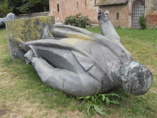 Collapsed and defaced statue of Petru Groza