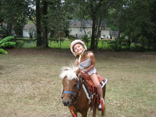 My granddaughter and her pony.