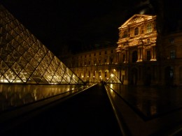 The Louvre Museum and Pyramid at night