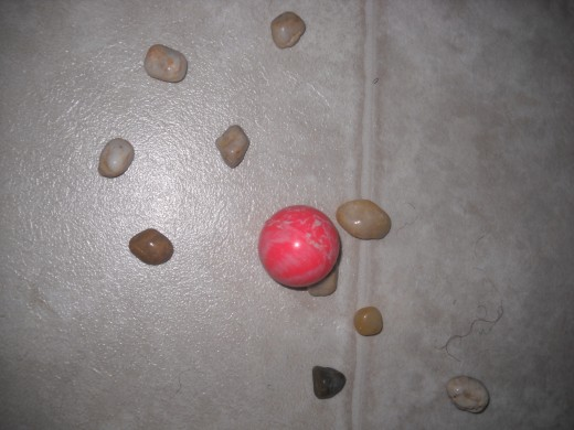 Playing jacks with pebbles or stones