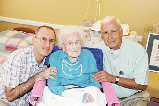 Cooper (center) celebrated her 115 birthday with grandson Paul (Left) and son Sidney