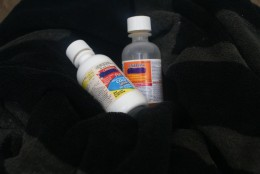 Medications to give for a fever lying on a fleece blanket that should not be used.