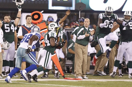 Tony Romo huge mistake as he throws to Jets' Darrelle Revis who intercepts the ball late in the second half.