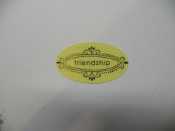Carefully Stamp the Friendship sentiment on the top yellow oval