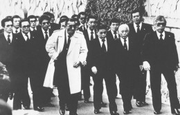 Yakuza often wear black suits, which are normally reserved for funerals.