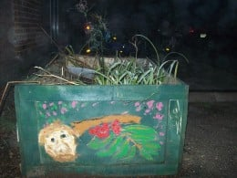 This is a garden box that I designed and decorated with this fairy or fairie that holds the fruits that protects people against demons.