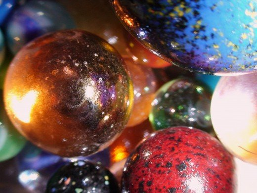 Use broken glass pieces and marbles to create jewelry or mosaic pattern decorations for your home.