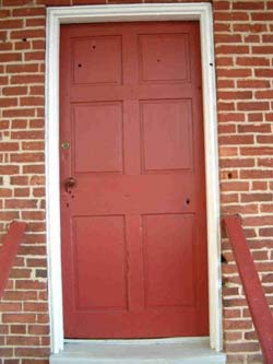 The door to Jennie Wade House, notice the bullet hole.