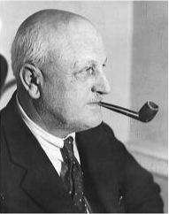 Ellis Parker in his trademark pose with a pipe