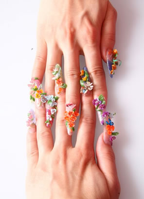 Acrylic nails designs 2012 come in different shapes and colors. Find out what types of acrylic nails designs are there for you.