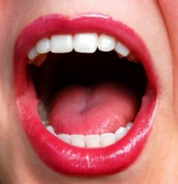 The mouth in a singing position or yelling