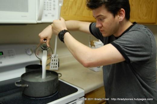 Dissolve sugar in water.