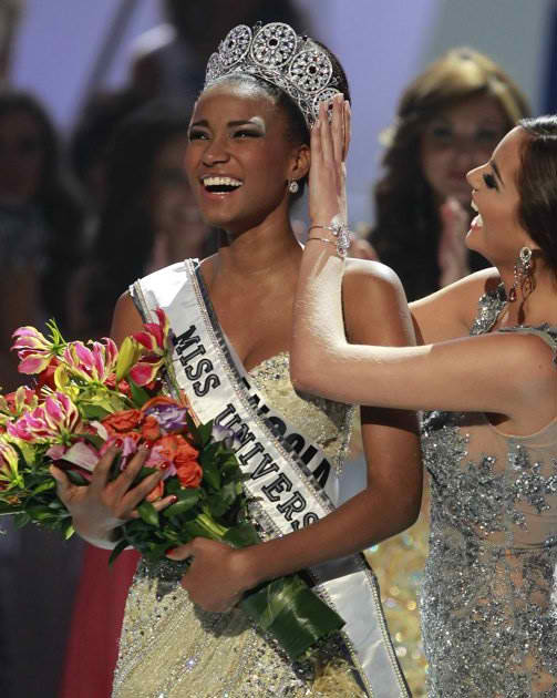 Newly crowned Miss Universe 2011 Leila Lopes of Angola as Miss Universe 2010 Ximena  Navarette of Mexico relinquished the title