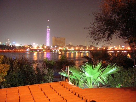 This is the Cairo Tower at night where you can eat dinner in a romantic style with your beloved. A beautiful view of the hotels overlooking the River Nile.