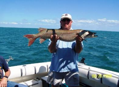 John Wonsowicz with Lake St. Clair muskie about to be released.