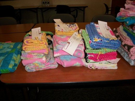 Blankets donated to children in need at monthly meeting.