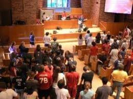 PEOPLE WORSHIPPING GOD. SATAN SHOULD NOT BE ANYWHERE IN THIS LOCATION.