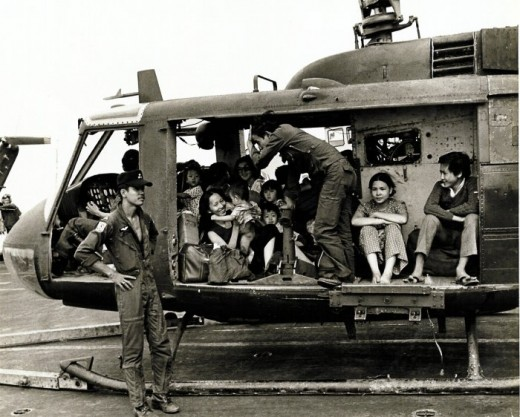 A VNAF UH-1H Huey loaded with Vietnamese evacuees on the deck of the U.S. aircraft carrier USS Midway (CV-41) during Operation Frequent Wind, 29 April 1975.