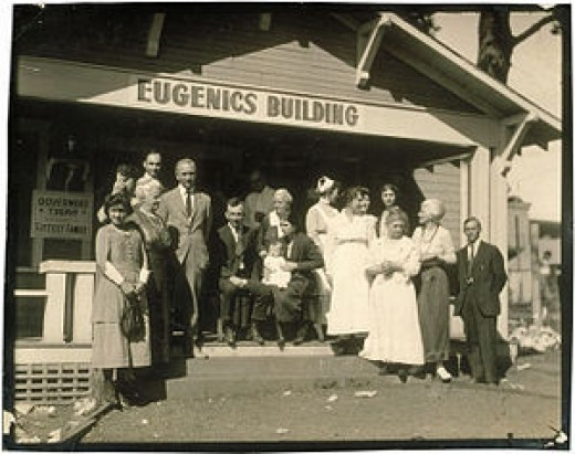 Winning family of a Fitter Family contest stand outside of the Eugenics Building (where contestants register) at the Kansas Free Fair, in Topeka, KS