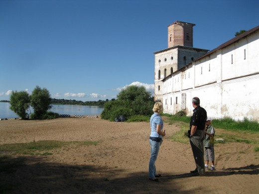 My wife, her brother and our nephew outside wall of Yuryev (St George)  Monastery on shore of Lake Ilmen near Veliky Novgorod, Russia.