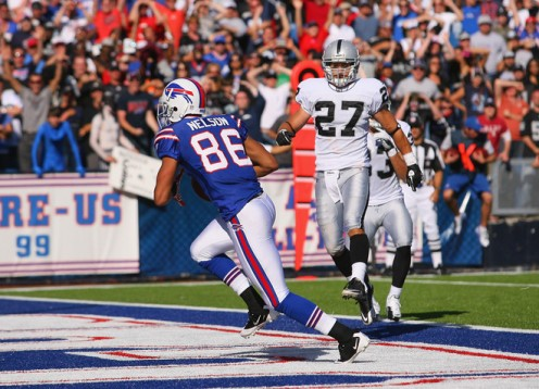 The Bills' David Nelson (86) catches the game-winning touchdown ahead of Raider safety Matt Giordano (27).
