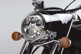 How could Kawasaki saddle a great cruiser like the Vulcan 2000 with this three-eyed alien happy face of a headlight?