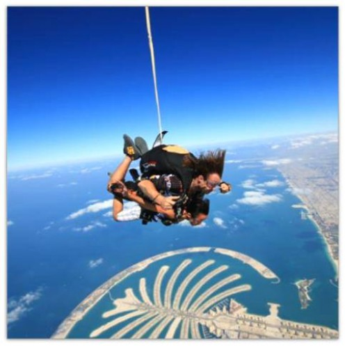"Sky-diving experience over the Palm Islands of Jumeirah, Dubai ( in the pic is  my very ""brave & adventurous"" cousin, Myra )"