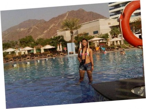 Enjoy the beach and the pool at Le Meridien Al Aqah Fujairah, bordering mountains on view