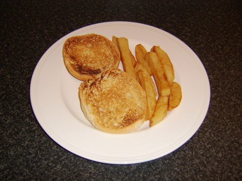 The toasted bap and the chips are plated
