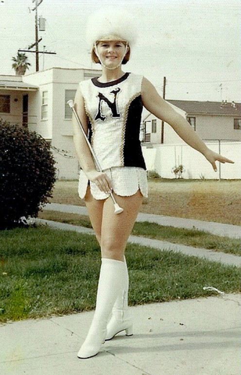 THE CLASSIC MAJORETTE WITH HEADDRESS. NO PEP RALLY OR PARADE WOULD BE COMPLETE WITHOUT A LEAD MAJORETTE.