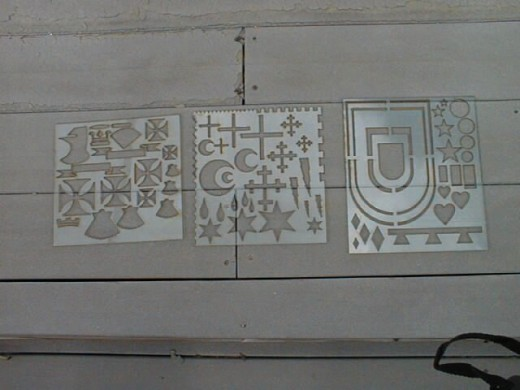 1. Lexan stencils that make many of the basic symbols of a coat of arms.