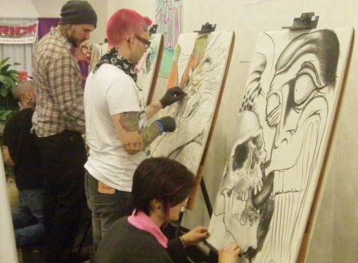 Cory Phillips (plaid) and Patty Mistress of Pain from PatysArtspot, participated in the first round of Art Fusion.