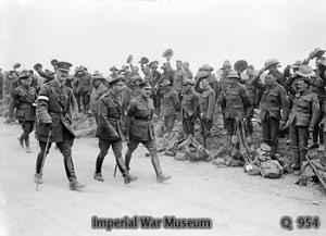 HM King George V (front centre) inspecting New Zealand battalions about to entrain at Steenwerck.
