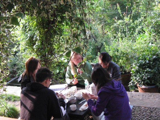 Guests having a meal with a Naxi family.