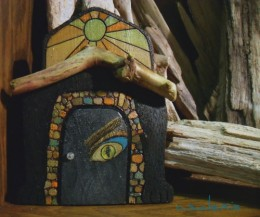 Mixed media artwork shows in this miniature Fairy Door from Adrift Art Studio shop Walk Softly13. A combination of wood burning, acrylic paint, graphic art, driftwood, jewelry findings and magical powers are found in this wonderful piece.