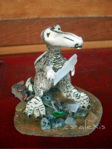 ICE is a one of a kind sculpture. Mixed media miniature fantasy artwork I call The Hail Maker
