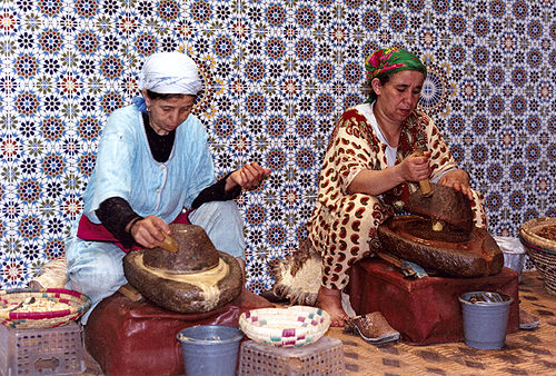 Berber Villagers preparing argan oil.