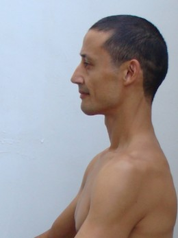 Although my upper back is still slightly rounded, it is less rounded than in the above photo.