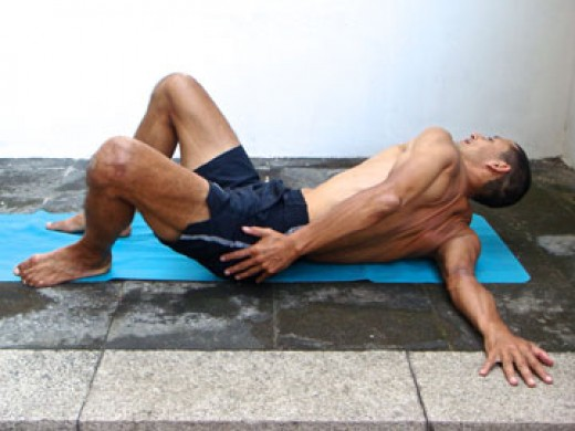 Roll towards you extend hand. You don't have to lift your knees straight away.