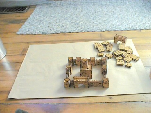 3.Miniature castle pieces assembled as a castle.  The whole thing would fit on a standard letter sized piece of paper.