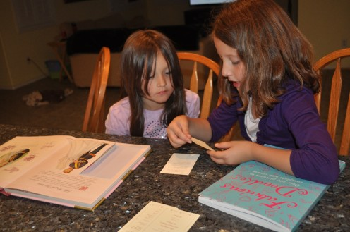 Abby helping her sister read all the secrets held in The Princess Primer. Both were very excited about their gifts!
