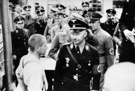Heinrich Himmler checking the men's camp at Dachau.