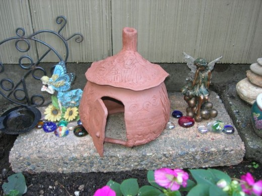 I made a clay fairy house and added some fairies that followed me home from the thrift store.